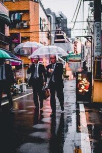 Asia Business People in the Rain