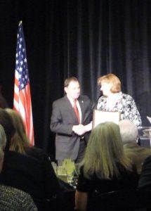 Nicole Toomey Davis with Utah Governor Herbert